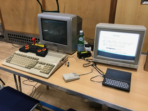 Binary Dinosaurs' Amiga A500 cozies up to a little Sinclair ZX81 which is borrowing the Commodore's monitor!